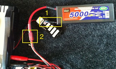 Photo of the battery connected to charger with connectors highlighted